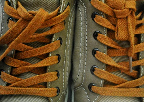 tan shoes with orange shoelaces